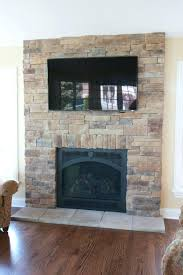 tv on stone fireplace wall hearth niche espresso leather chairs attaching mount to stand with