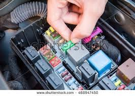 fuse box stock images royalty images vectors shutterstock hand checking a fuse in the fuse box of a modern car engine