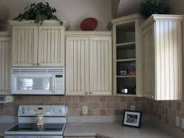 great refacing kitchen cabinets ideas with tile backsplash and white appliances