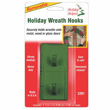 magic mounts removable self adhesive dark green wreath hook is used on a composite door which is upvc and has a wood grain finish effect on the outside