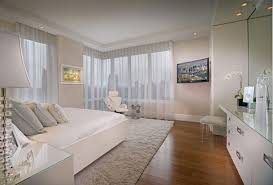 beautiful bedrooms with a view. beautiful showcase creating stylish interior impression : view of nyc skyline from the white bedroom bedrooms with a