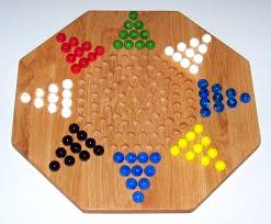 Game With Marbles And Wooden Board