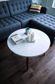 Alluring White Round Table Over Hardwood Flooring And Charming Navy Blue  Colors Sofa West Elm Tillary
