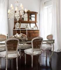 chic modern french dining room design with gray cane back french dining chairs gray gl top french dining table gray walls paint color espresso wood