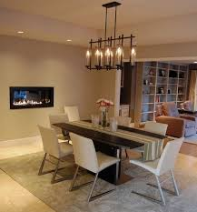 view in gallery chandelier above the dining table complements the fireplace stylishly