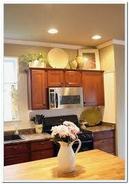 image of ideas for decorating above kitchen cabinets