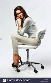 student sitting in chair. Exellent Sitting Young Happy Businesswoman Sitting On The Office Chair Gray Background   Stock Image And Student Sitting In Chair R