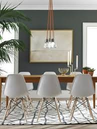 this chair flaunts a mid century modern design and fresh and clean look for a dining room or living room these eames inspired chairs are a stylish
