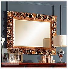 mirror in carved wood frame in a matte finish coating alyssa arve style