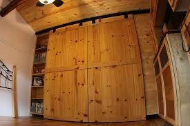 unfinished pine woode bedroom barn closet doors combined with bookshelf with and metal sliding barn doors