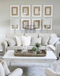 simple display of tan matted photos source thistlewoodfarms com this living room wall decor