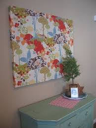 diy wall art nail strips of wood together and staple fabric over all ta