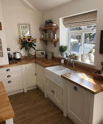 wood natural wood counter tops with white cupboards dark drawer pulls counter