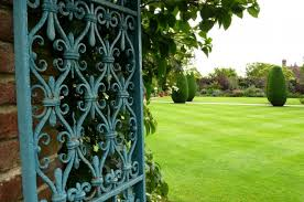 a gate at sissinghurst castle painted a lively blue this color would have been