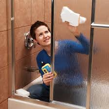 how to remove hard water stains from glass shower doors