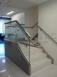 laminated glass railings top mounted to aluminum base shoes then later covered in stainless the stainless steel