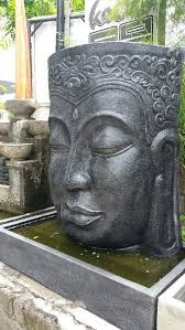 large buddha face wall water feature