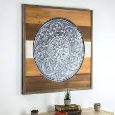 metal framed wall art framed metal medallion on wood wall hobby lobby framed metal wall art