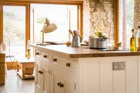 Traditional country kitchens Oak Traditional Country Kitchen 17th Century Grade Ii Listed Barn Conversion With Oak Worktops And Cabinets Painted In Farrow Ball Tallow Sustainable Kitchens Stevens Traditional Country Kitchen Sustainable Kitchens