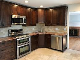the updated kitchen with custom cabinets granite countertops stainless steel appliances and a wine refrigerator will be perfect