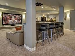Simple basement ideas that turn your extra space into a finished movie  theater.
