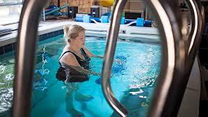 patient exercising in pool