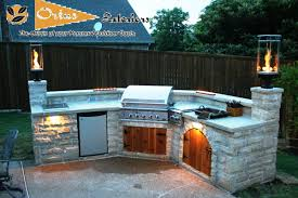 outdoor kitchen lighting ideas. Patio Lighting Ideas With Marble Floor And Stone Kitchen Bench Also Built In Stove Grill Moounted Lamps Dishwasher Combine Green Outdoor T