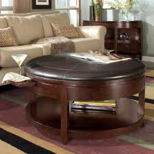 round upholstered leather top coffee table with storage shelf and pull out drink tray a