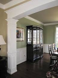 dining room with custom millwork archway chair rail and panel moulding shadowbo idea for hallway