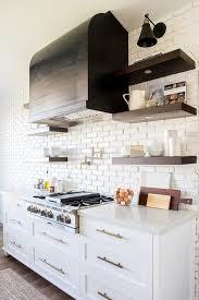 dark stained kitchen shelves on white brick wall
