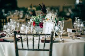 each table setting contained wine glass champagne glass water goblet plate flatware and napkin