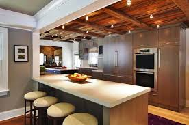 False Ceiling In Kitchen With Wood Ceiling And Bar Stool And Light