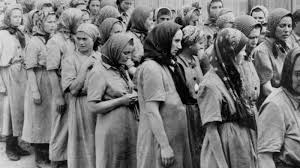 a timeline of the holocaust my jewish learning forced labor at auschwitz birkenau toward their barracks after disinfection and head shaving 1944 united states holocaust memorial museum