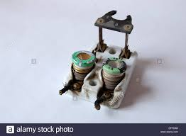 1950s vintage ceramic fuse box electrical circuit breaker with Ceramic Fuse Box 1950s vintage ceramic fuse box electrical circuit breaker with fuses and knife switch plain background natural ceramic fuse blown