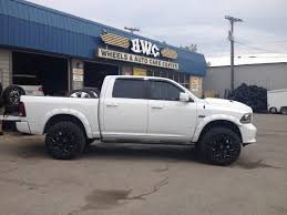 white dodge ram lifted. Modren Lifted Lifted Chevy Astro Van And White Dodge Ram