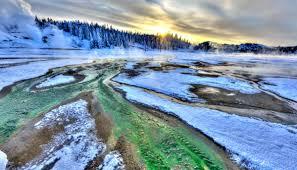 winter sunset in yellowstone s norris geyser basin