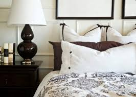 white bedroom with dark furniture. white bedroom with dark furniture
