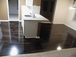 Glossy Dark Laminate Flooring For Kitchen With White Kitchen Island And  White Marble Countertop Also ... Ideas
