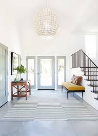 bright and airy entryway // spacious entryway // gray and white ...