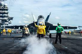 u s department of defense photo essay u s sailors on the flight deck of the uss george washington signal to the pilot of