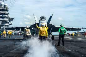 u s department of defense photo essay u s sailors on the flight deck of the uss george washington signal to the pilot of