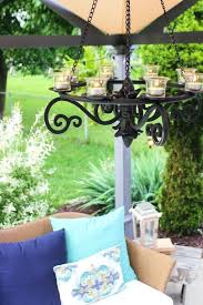 i spied this affordable hanging gazebo chandelier but it is listed as black metal votive