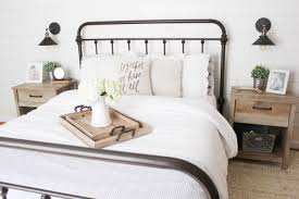 master bedroom. Farmhouse Master Bedroom With Metal Bed Frame And Sauder Cannery Bridge Nightstand