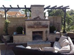 travertine veneered diy outdoor fireplace with planterantel sedona design built by a