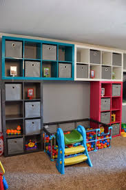 IKEA playroom diy ball pit, also shows a neat idea for a train/lego  table.this is a legit playroom.
