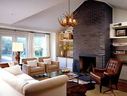 glazed bricks with marble fireplace surround family room