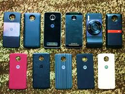 motorola moto z. (l-r top) moto mod insta-share projector, incipio offgrid power pack, z play, z, hasselblad true zoom camera, jbl soundboost speaker, motorola