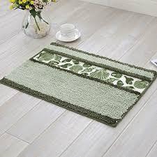 green decorative seashell pattern area rug