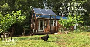 Tiny House With Solar Panels Lawn And Chicken In The Foreground