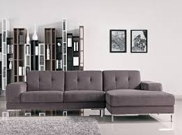 simple modern living room. Simple Modern Living Room Decoration With Dark Gray Tufted Sectional Sofa Chaise And Stainless Steel Legs Plus Wall Bookshelf Storage Ideas O